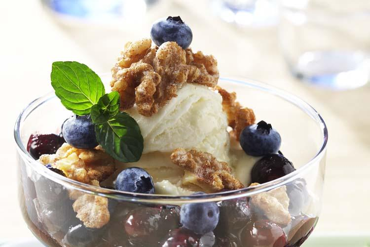Frozen Yogurt Sundae With Blueberry Compote and Glazed Walnuts